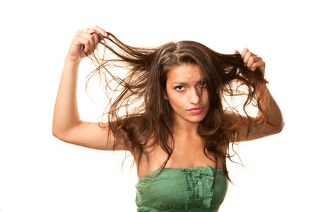 messy: Beautiful Hispanic Woman with Messy Brunette Hair Stock Photo