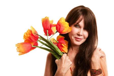 mujer hippie: Mujer bonita hippie con Tulipanes de pl�sticos brillantes Foto de archivo