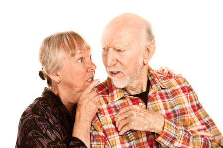 spat: Senior woman pointing her finger and husband