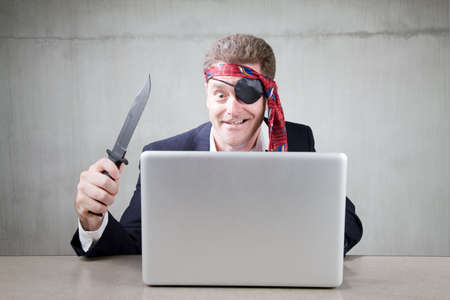 Eccentric business man acting as Internet pirate photo