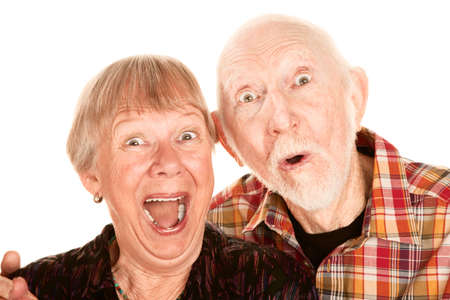 Senior couple with surprised and happy expressions photo