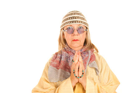new age: Crazy new age woman with beads in a yellow robe