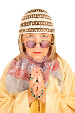 Crazy new age woman with beads in a yellow robe photo