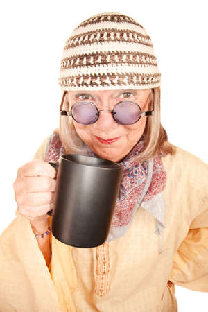 newage: Crazy new age woman in a yellow robe smiling with coffee cup