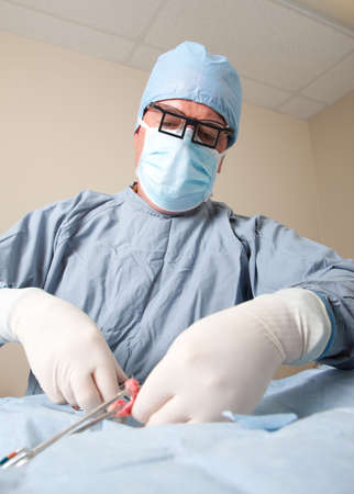shroud: Veterniarian performing spay operation on small dog