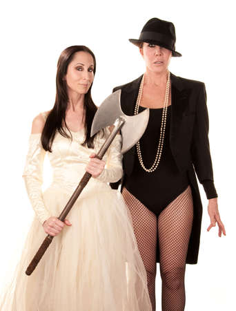 Two women dressed as traditional bride and groom with axe photo