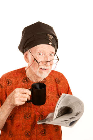 new age: Skeptical New Age Man with Coffe and Newspaper Stock Photo