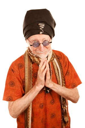 new age: Handsome senior new age man giving blessing with hands clasped