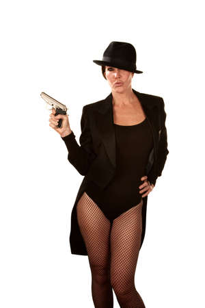 fedora: Woman gangster in fsihnet stockings with pistol Stock Photo