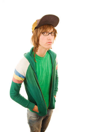 Teenage garçon dans cap veste et le ballon avec les mains dans les poches Banque d'images - 6121110