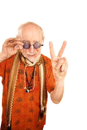 newage: Scowling senior man making peace sign with fingers