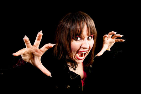 Female Vampire on Black Background Making a Threatening Face