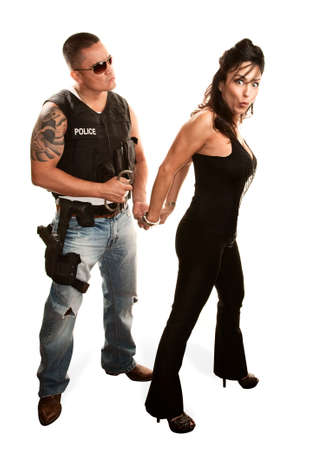 Macho policeman arresting pretty Latina woman photo
