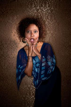 Pretty African American Woman Wearing Blue Dress Caught in Spotlight