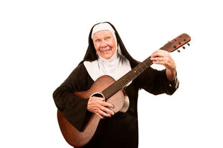 religious habit: Funny singing nun with old guitar in black habit