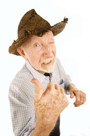 Handsome senior man wearing straw cowboy style hat photo