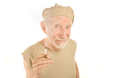 Senior Man with Ragged Shirt and Lit Cigarette photo