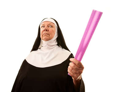 Angry senior nun brandishing ruler as weapon
