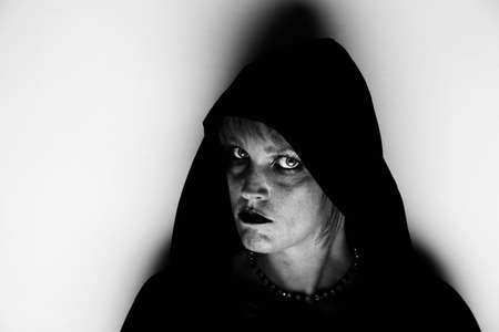 newage: Witch in black hood standing in corner