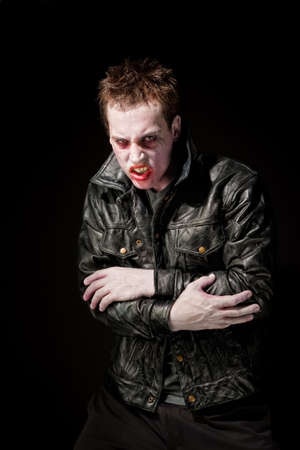 zombies: Angry young male zombie in black leather jacket