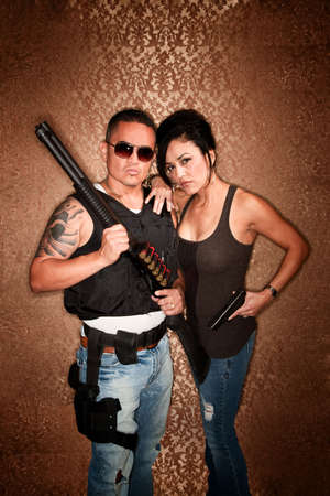 undercover: Glamorous Undercover Cops or Criminals with Shotgun and other Firearms Stock Photo