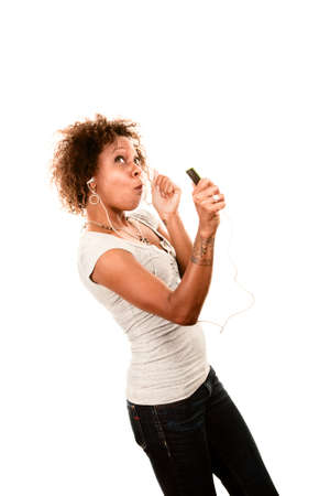 listening device: Pretty African American Woman Dancing with Personal Listening Device
