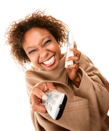 sleeve: Woman wearing blanket with sleeves with phone and TV remote Stock Photo