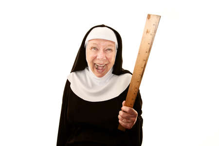 cackle: Crazy ;laughing nun on white brandishing a ruler Stock Photo