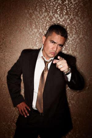 Angry Handsome Hispanic Man on Gold Background 免版税图像