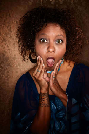 Surprised and shocked African American woman caught by photographer photo