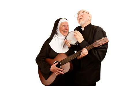 Portrait of funny musical priest and nun with instruments photo