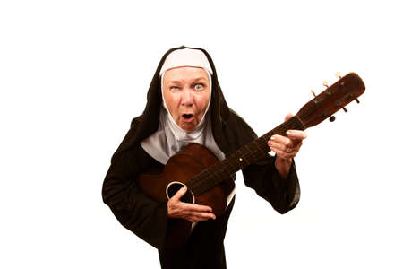 nun: Portrait of eccentric singing nun with evil expression on her face Stock Photo