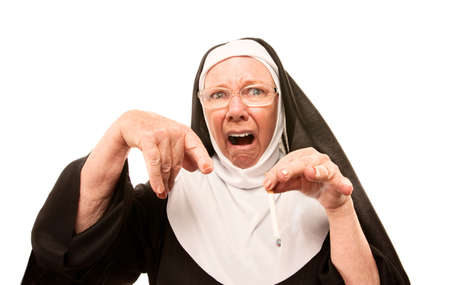 confiscated: Eccentric nun in glasses pointing to confiscated cigarette