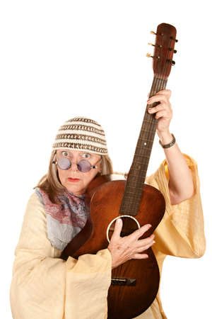newage: Crazy New Age Woman with Old Guitar Stock Photo