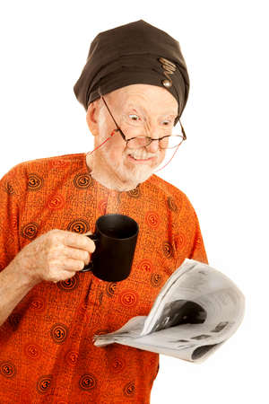 new age: Skeptical New Age Man with Newspaper and Coffee Stock Photo