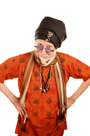Skeptical senior guru in orange shirt with hands on hips photo