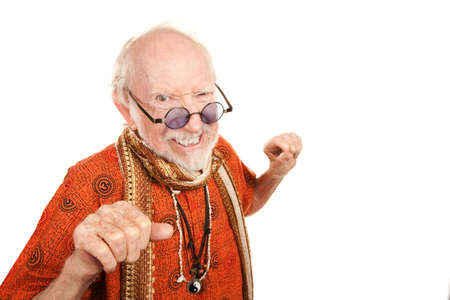 new age: Funny senior new age man throwing a punch