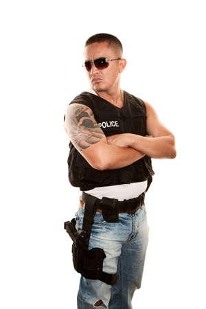 intimidating: Tough Hispanic Cop with Pistol in Bulletproof Vest