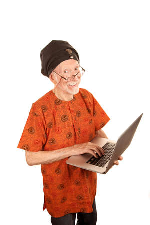 Senior computer guru with shiny silver laptop Stock Photo - 6320932