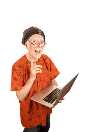 Senior computer guru with shiny silver laptop Stock Photo - 6320931