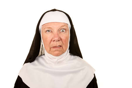 enraged: Funny Nun with Angry Expression on her Face Stock Photo
