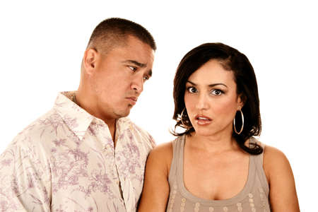 skepticism: Attractine Hispanic Couple on White Background Showing Skepticism or Anger