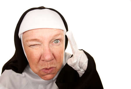 nun: Funny Nun with Angry Expression on her Face Pointing a Finger