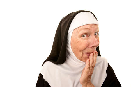 Funny Nun with Happy Shocked on her Face Stifling a Laugh Stock Photo