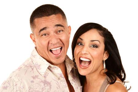 Portrait  of Laughiong Hispanic Couple on White Background photo
