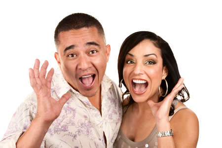 Laughing happy Hispanic couple with surprised expressions photo