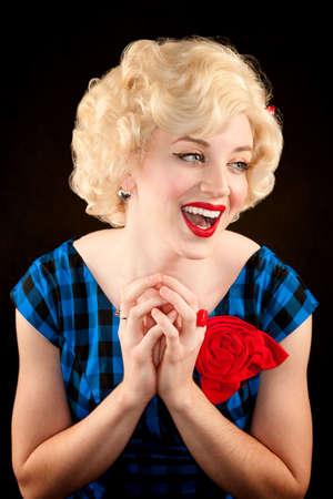 starlet: Pretty retro blonde woman in vintage 50s dress