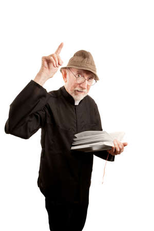 Angry priest or pastor giving fiery sermon from Bible photo