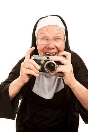 Funny Nun with Vintage Camera and Big Glasses photo