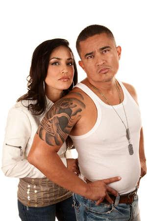 tough: Tough attractive Hispanic couple on white background Stock Photo